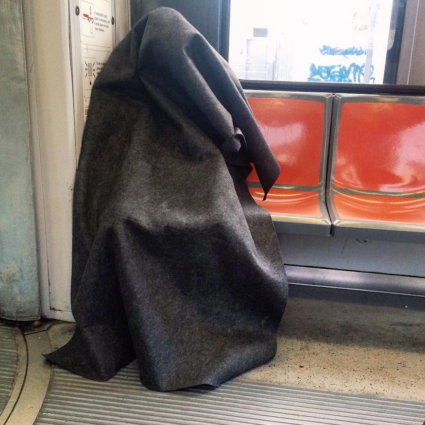 man wearing blanket on muni by kevinkelleher